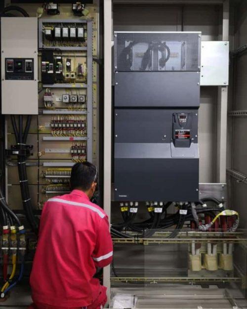 Engineer replacing power inverter